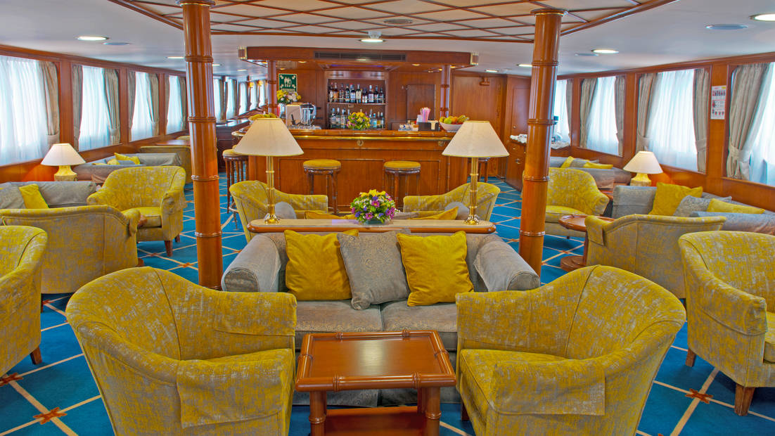 Lounge with many chairs and bar aboard Callisto.