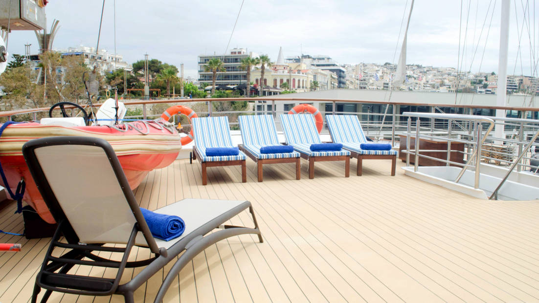 Lounge chairs on sun deck aboard Callisto while docked in port.