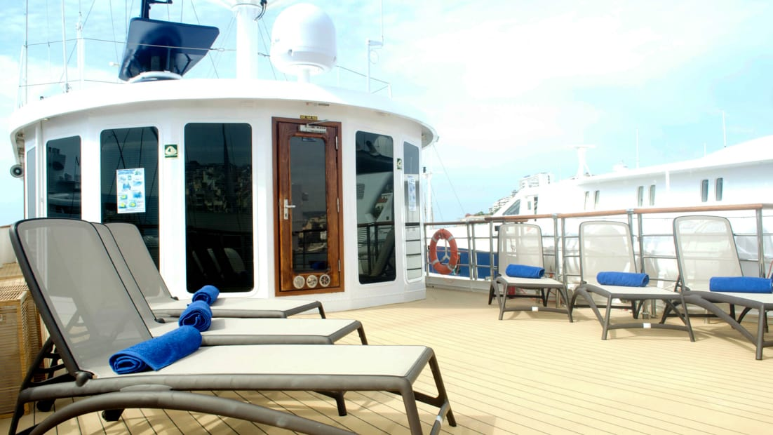 Sun deck with lounge chairs aboard Callisto.