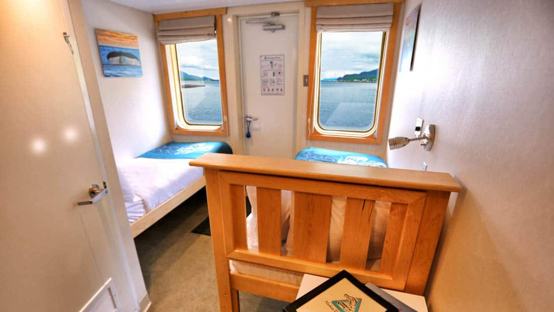 Category AA stateroom aboard Chichagof Dream with small windows and twin beds