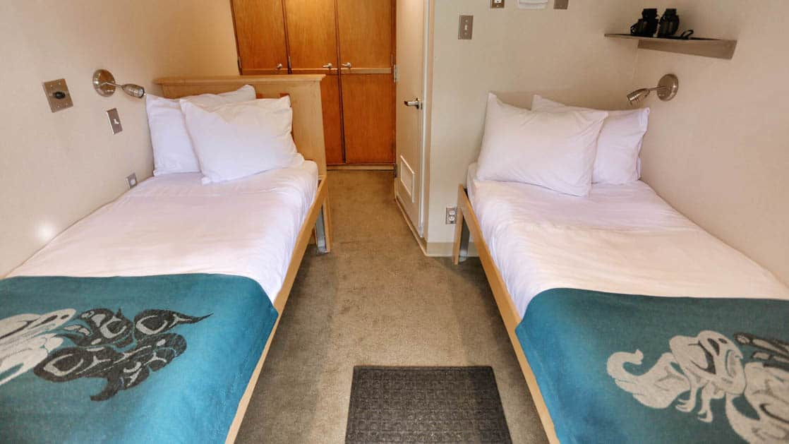 Category AA stateroom aboard Chichagof Dream with two twin beds.