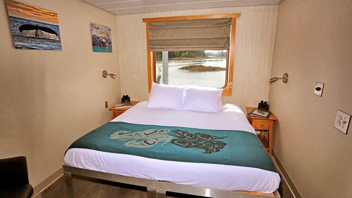 Category AAA stateroom aboard Chichagof Dream with bed and window.