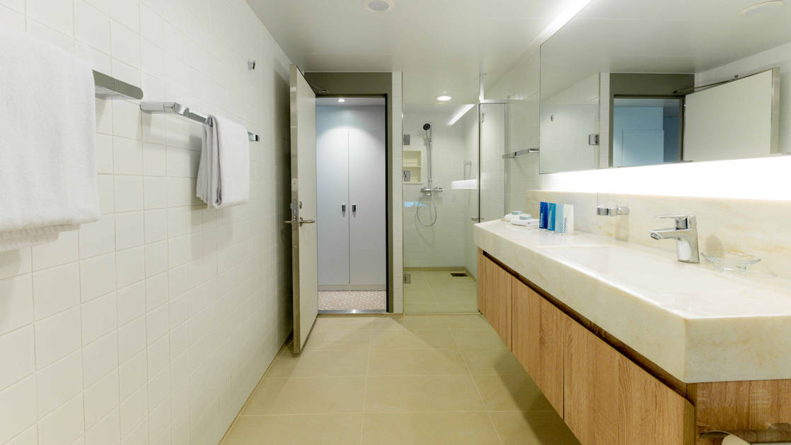 Bathroom with shower in the bridge deck suite.