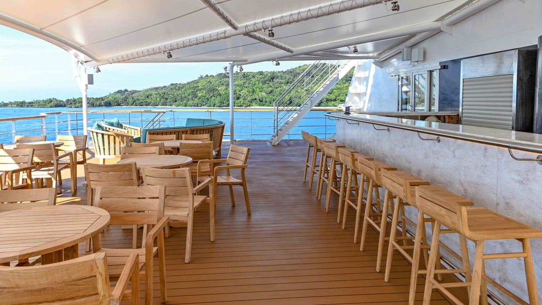 Bridge deck bar outside with shade aboard Coral Adventurer.