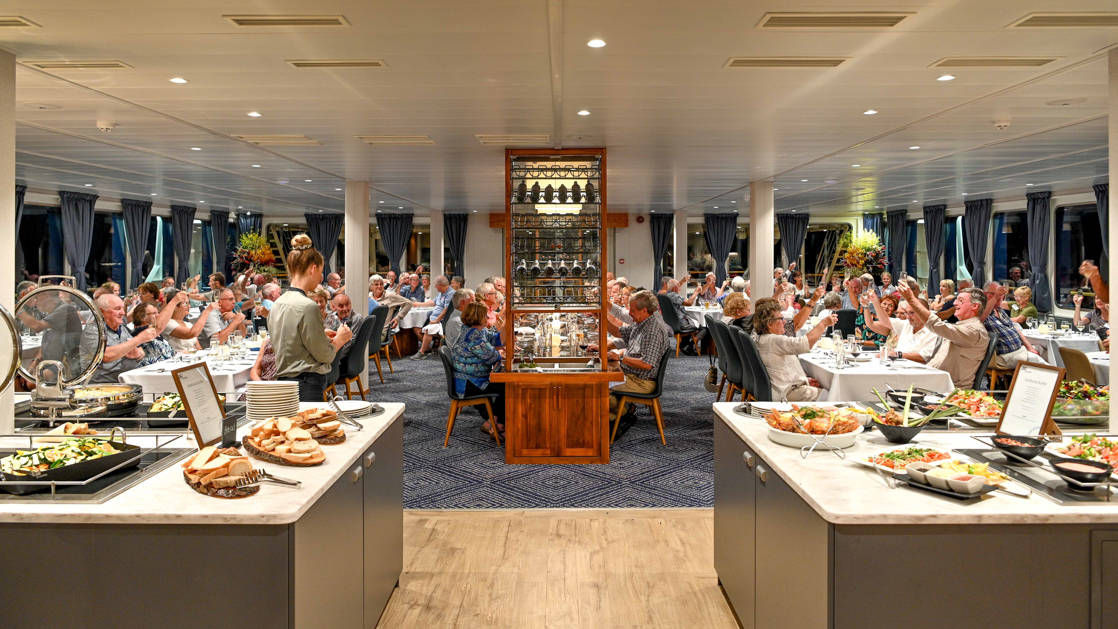 Full dining room with buffet meal aboard Coral Adventurer.