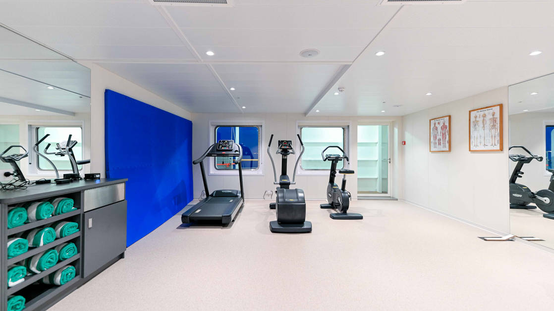 Fitness gym with machines and weights aboard Coral Adventurer.
