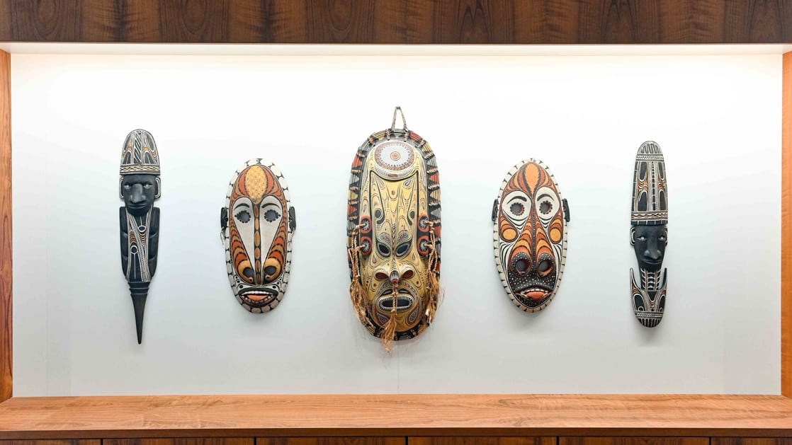 Indigenous australian artwork and masks aboard Coral Adventurer.