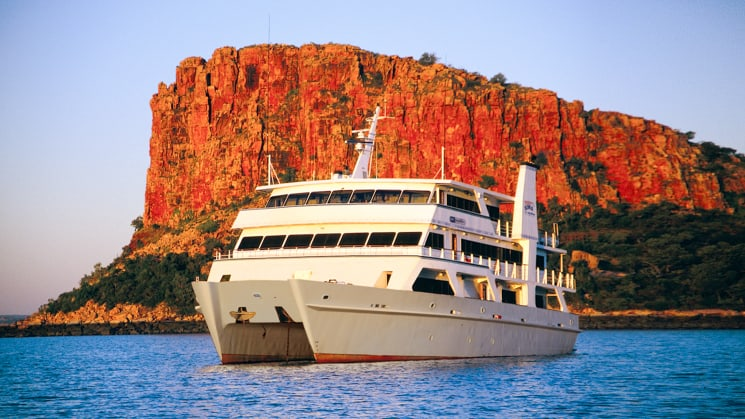 Coral Expeditions I cruising by raft point in Australia during sunset.