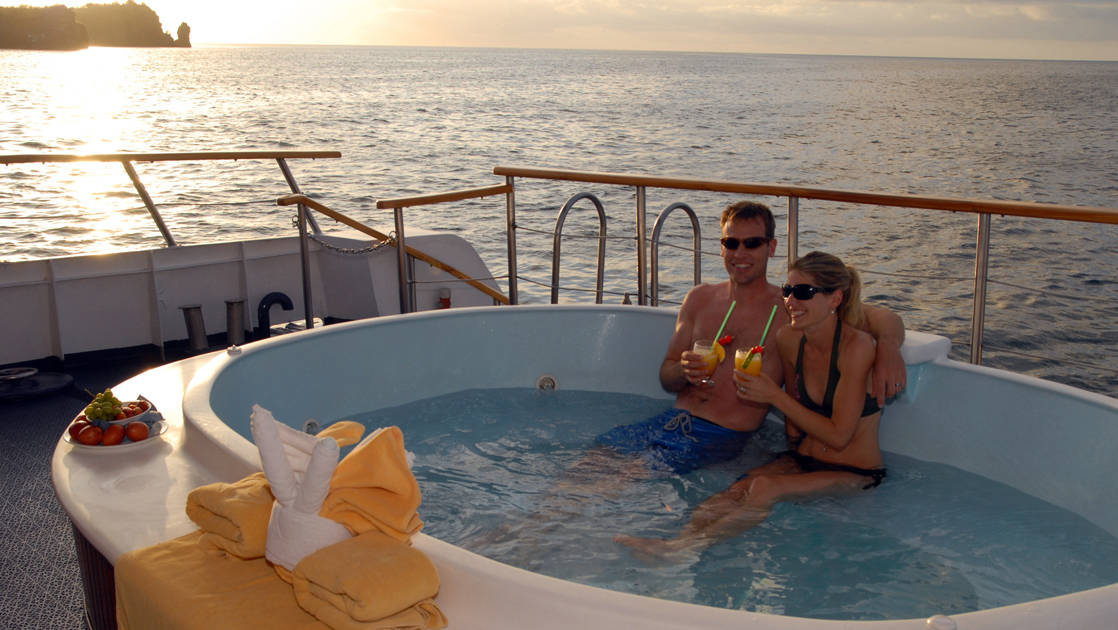 Man and woman in Jacuzzi aboard Coral I & Coral II yachts in the Galapagos Islands