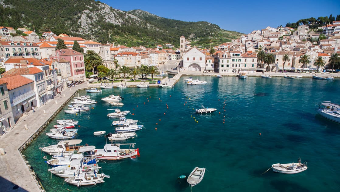 hvar harbor on the dalmatian coast in croatia filled with yachts and small ships atop the beautiful mediterranean