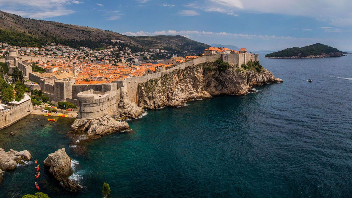 Dalmatian Coast Cruise view of Dubrovnik Croatia showing steep shoreline with houses perched on top