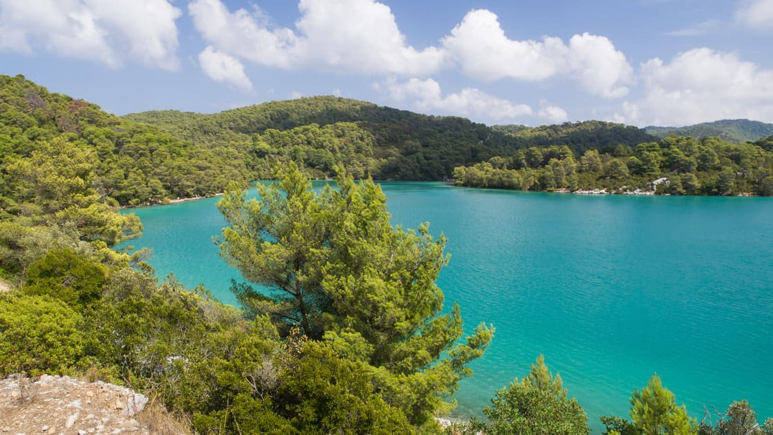 looking down at the turquoise water in mljet national park croatia on a sunny day during the dalmatian coast cruise