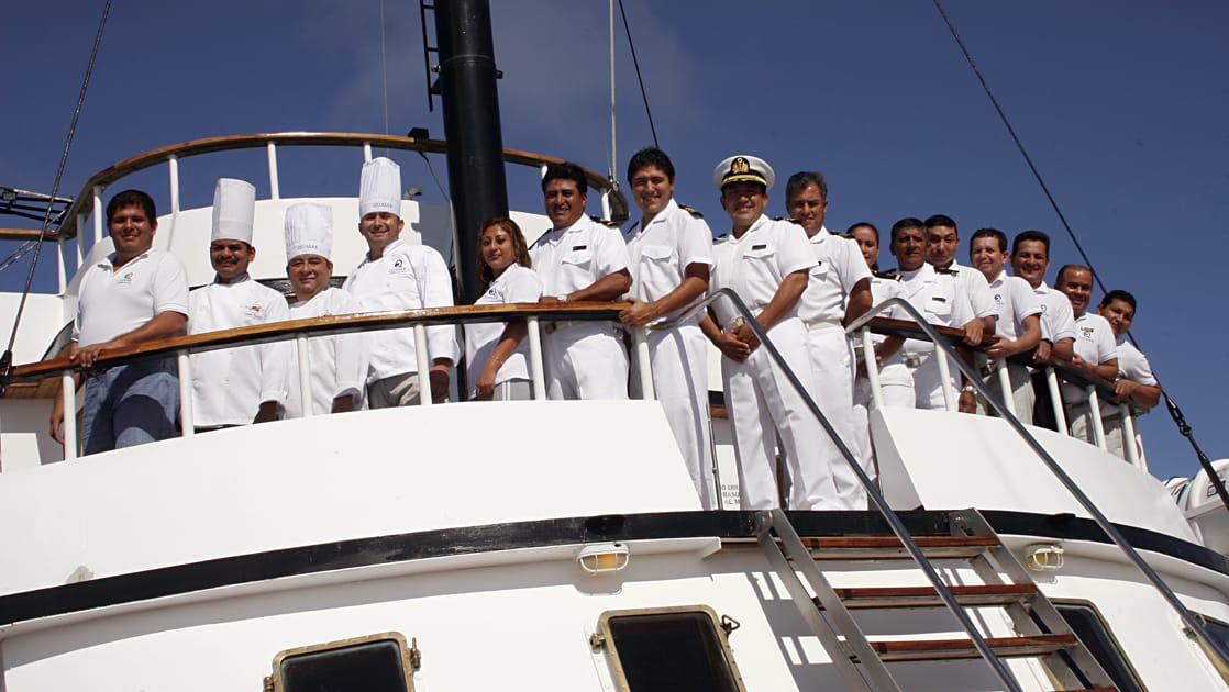 The crew of the Evolution on the upper deck of the ship.