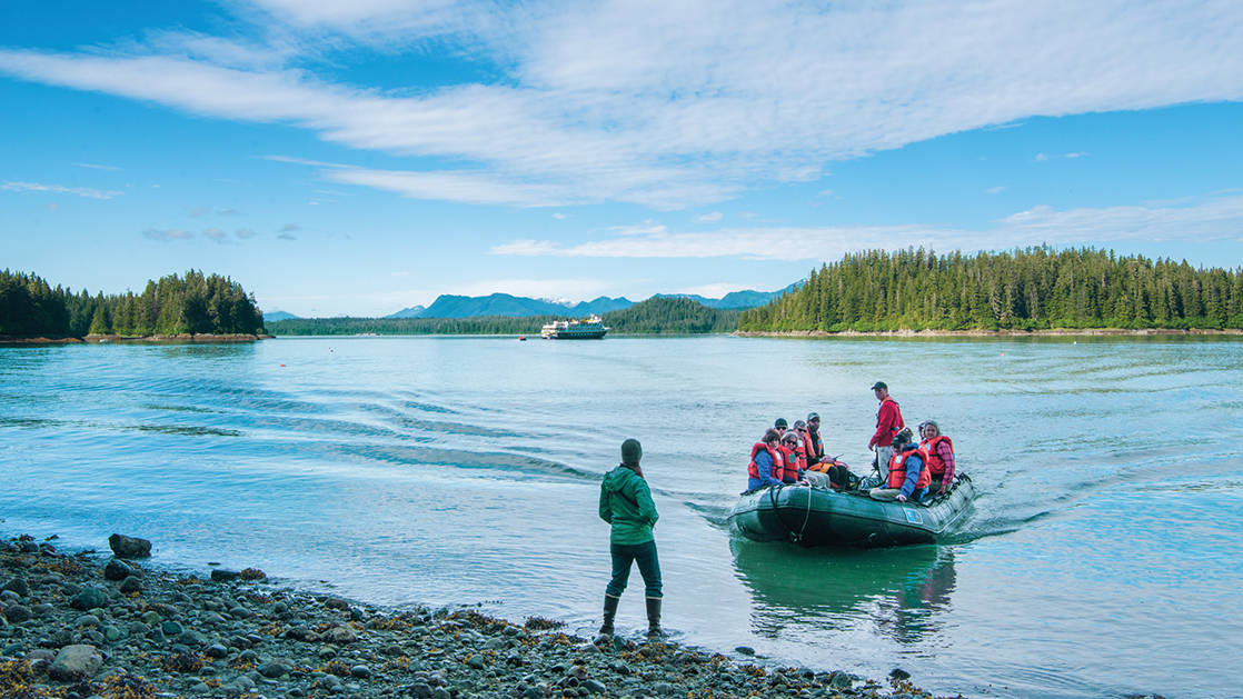 a group of adventure travelers coming ashore from the Exploring British Columbia & the San Juan Islands small ship cruise in the pacific northwest