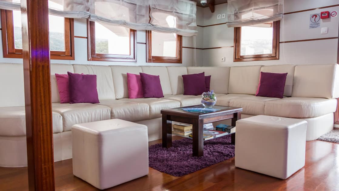 Small ship cruise Futura lounge with couch and coffee table.