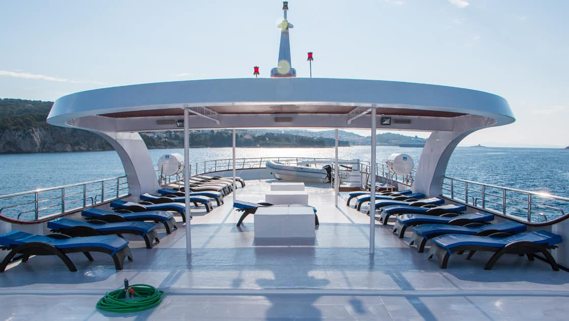 Small ship cruise Futura sun deck with lounge chairs.