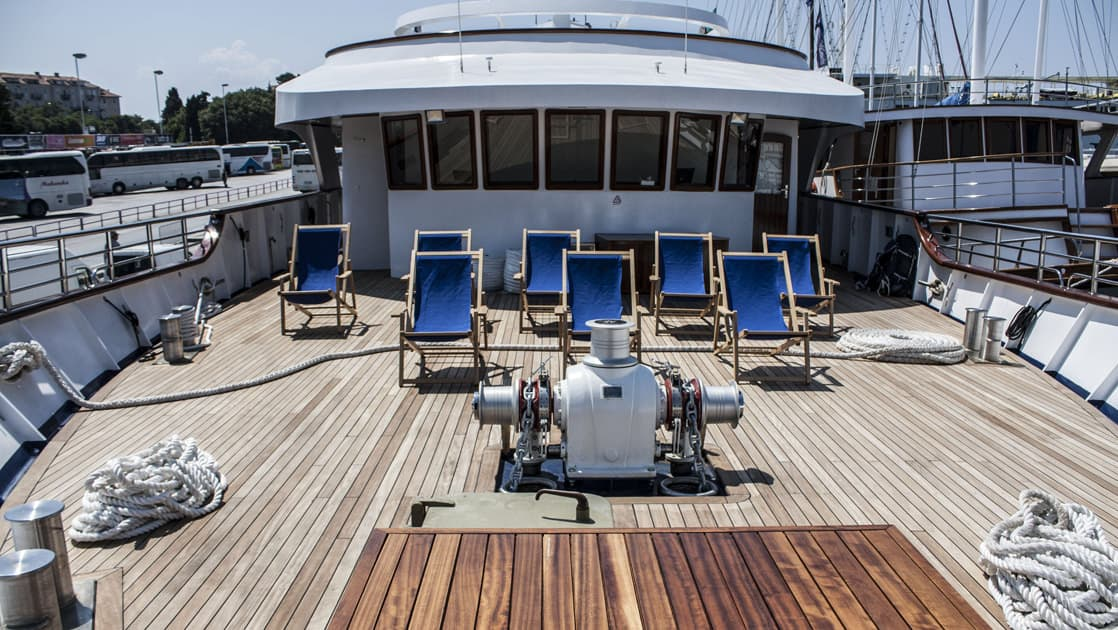 Small ship cruise Futura deck on the bow with lounge chairs.