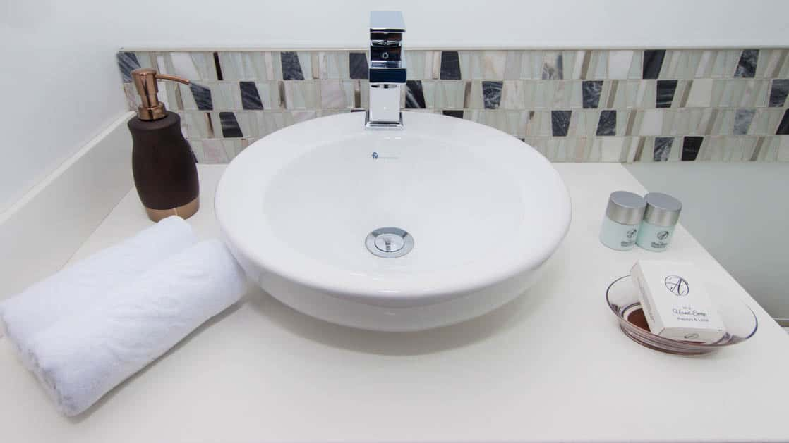 Up close of the sink and bathroom toiletries provided in a cabin aboard Alya.