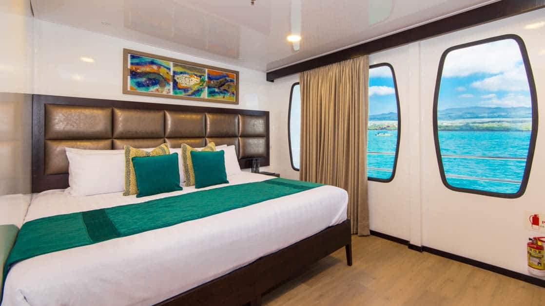Double Cabin aboard Alya with large bed and large windows.