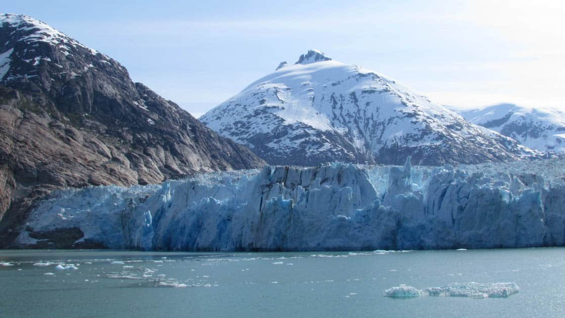 margerie glacier in alaska from the water on a partly sunny day
