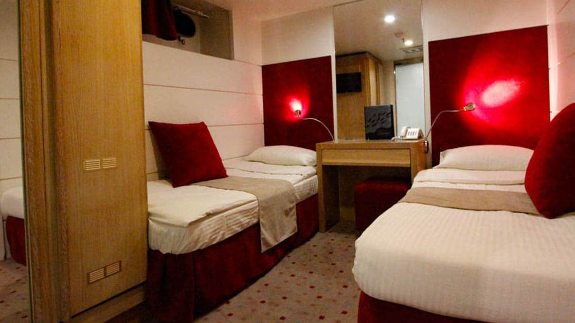 Harmony G yacht Category C stateroom with 2 twin beds, nightstand, reading lights and closet.