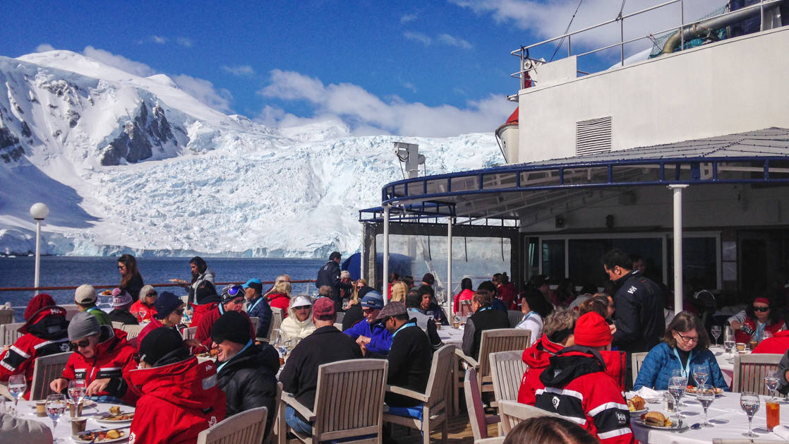 Outdoor dining with passengers on the sun deck of the Hebridean Sky.