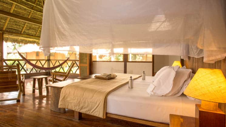 The Tambopata Suite at Inkaterra Reserva Amazonica offers guests a luxurious rainforest retreat in an 840-square-foot bedroom with one king bed, a walk-in closet and large windows.