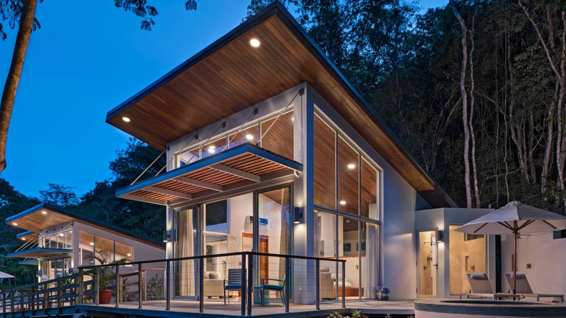 Glass walls allow incredible natural light into the modern living spaces of the villas at Chaa Creek Jungle Lodge in Belize