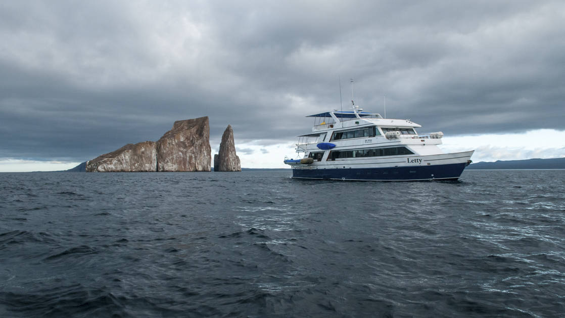 Letty anchored next to Pinnacle Rock in the Galapagos.