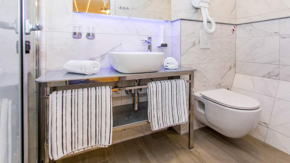 Maritimo bathroom with vanity, sink, shower and toilet.