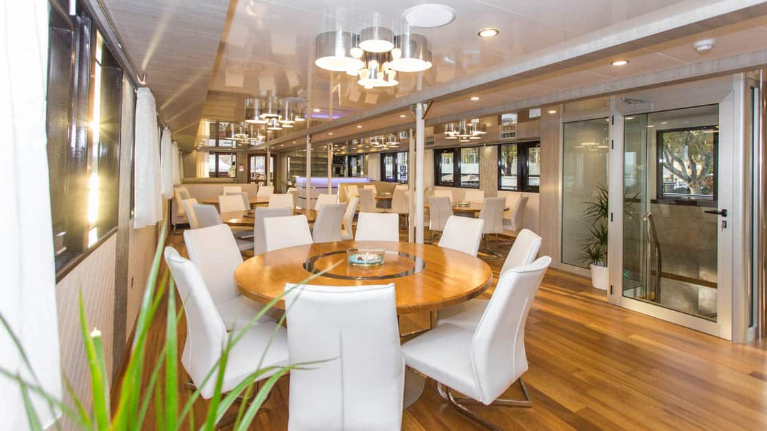 Maritimo Dining Room with tables, chairs and windows with a contemporary fee.
