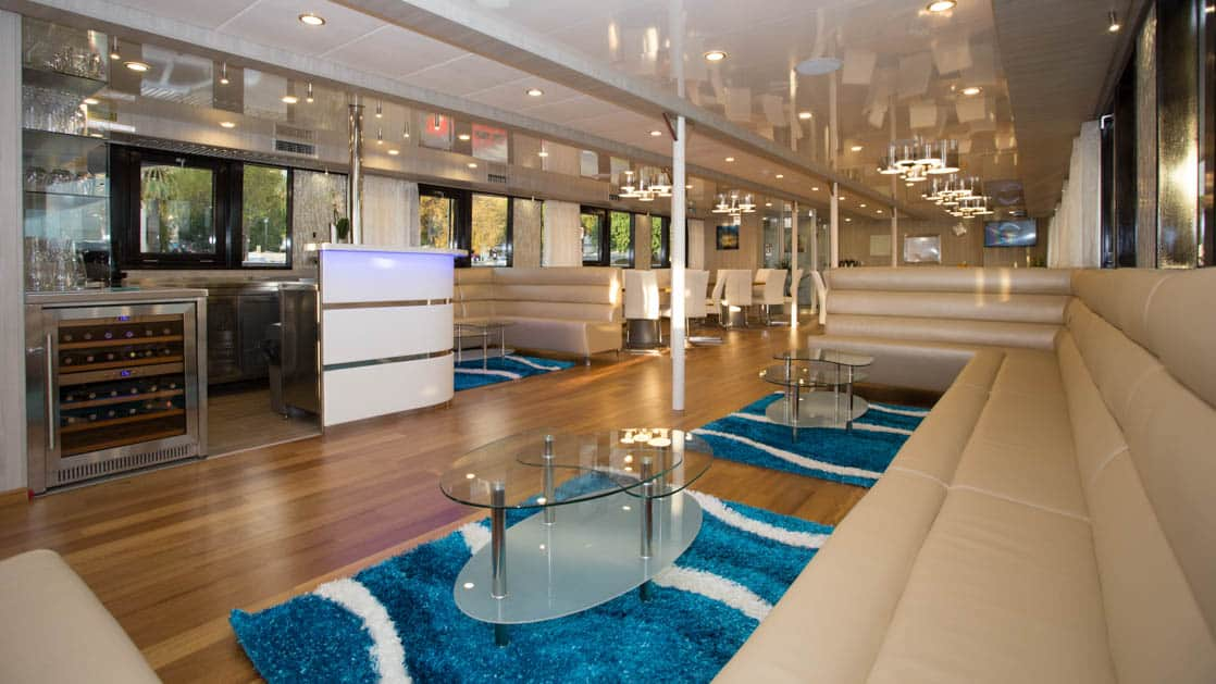 Maritimo lounge with bar, banquette seating, coffee tables and large picture windows.