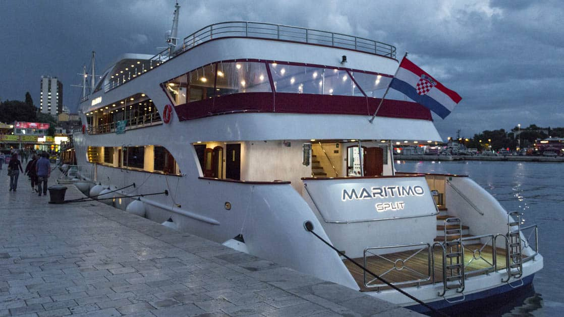 Maritimo stern view at dusk docked at port in Croatia.