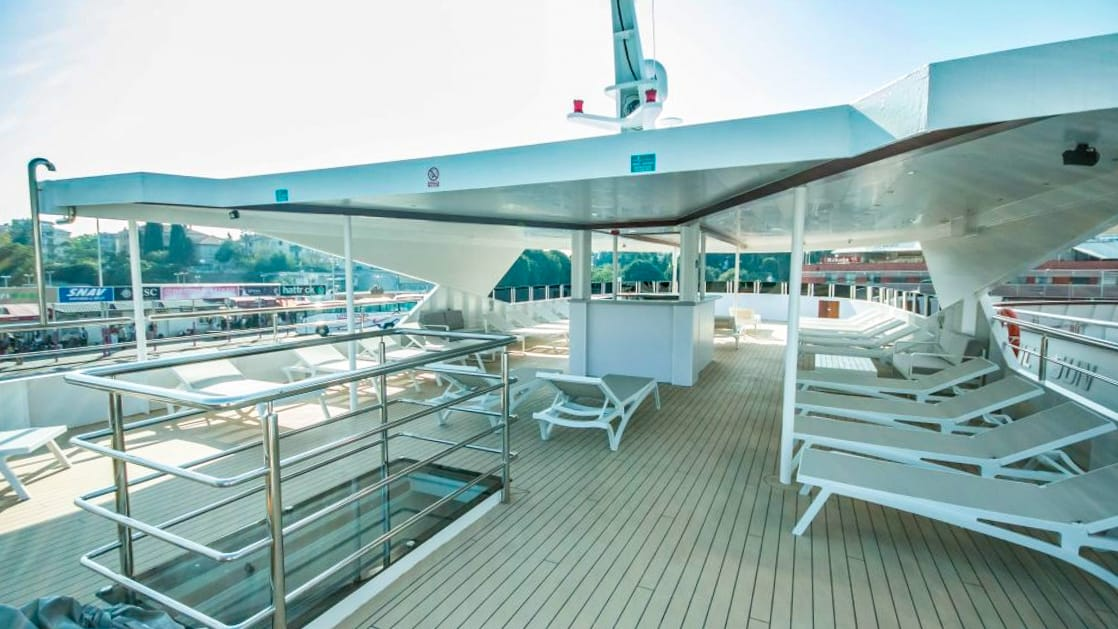 Markan covered sun deck with lounge chairs and stairwell to lower deck.