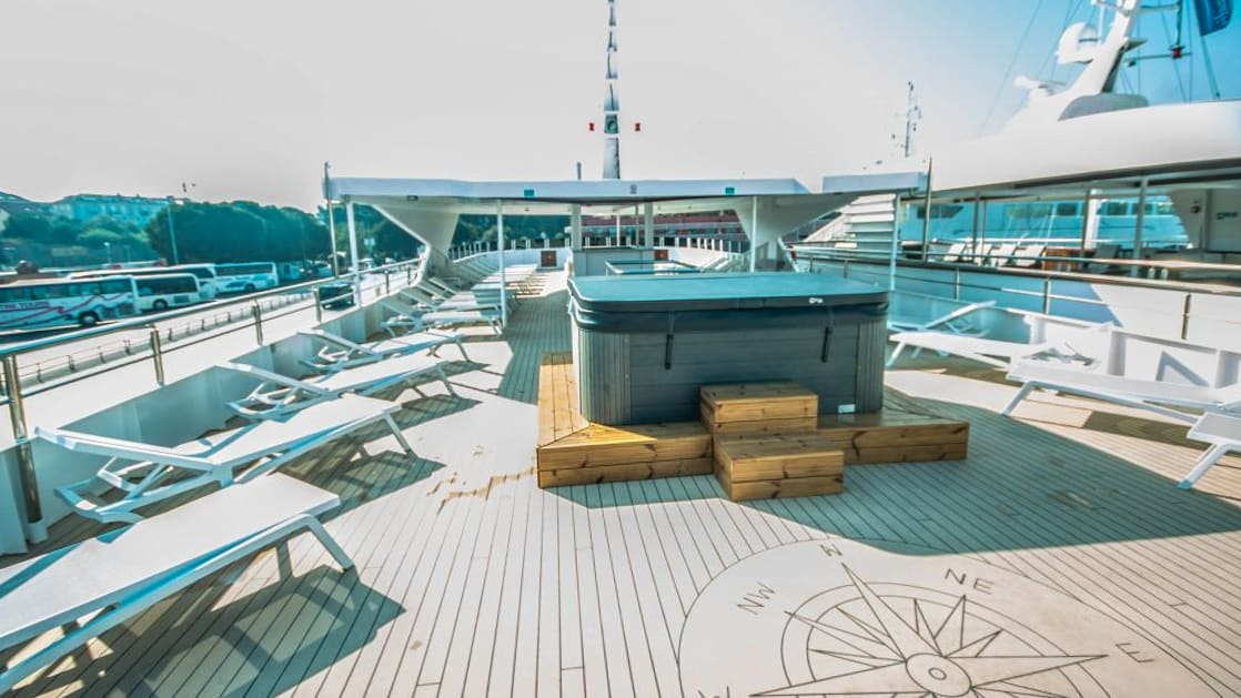 Markan sun deck with hot tub and lounge chairs.