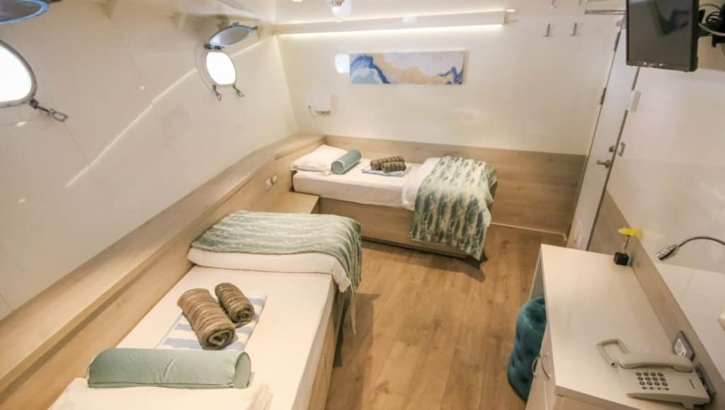 Cabin #13 with fixed twin beds aboard Nautilus
