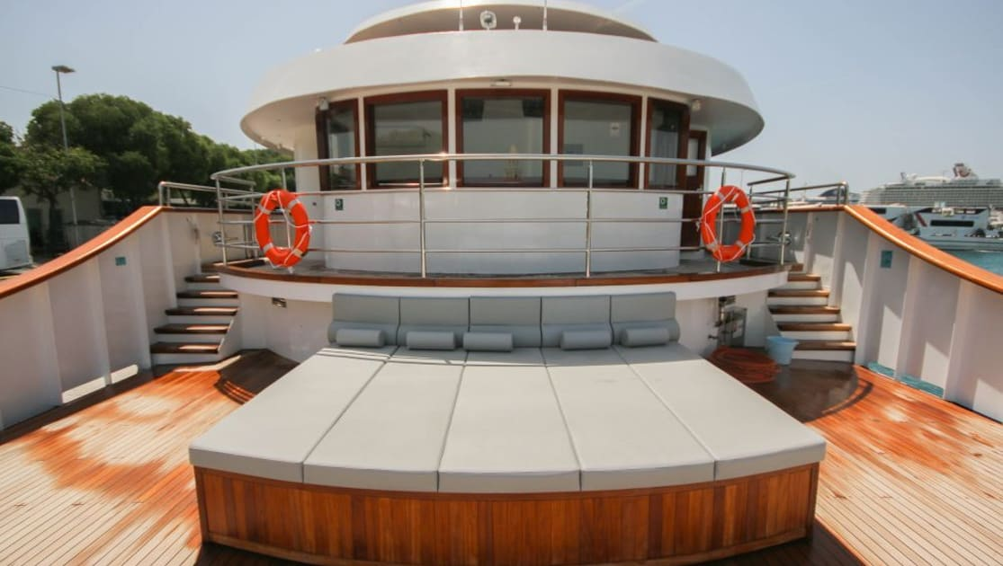Sun Deck with long chaise daybeds and bright teak decking in front of captain's Bridge aboard Nautilus Croatia & Mediterranean deluxe small yacht.