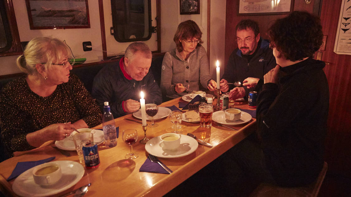 guests eating a meal aboard the noorderlicht