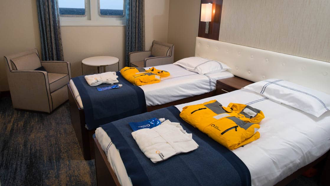 room with 2 beds and windows aboard the Ocean Adventurer