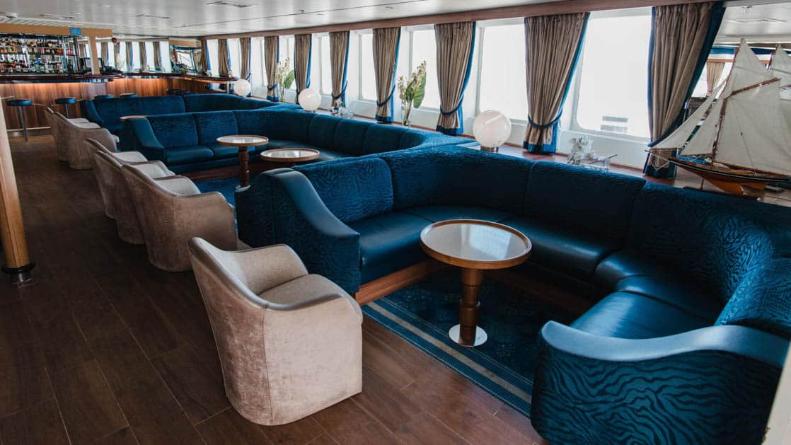 Antarctic Cruise Club with white chairs and blue couches aboard Ocean Diamond small polar ship.