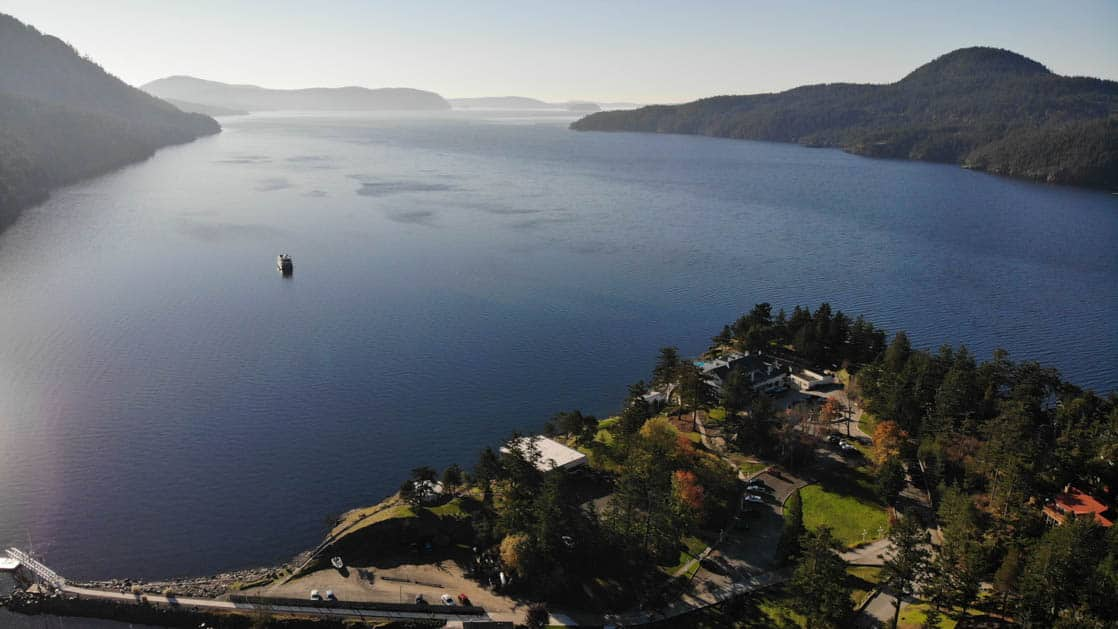 looking down at orcas island in the pacific northwest during the Olympic Wilderness & San Juan Islands cruise with the safari quest small ship anchored in the distance