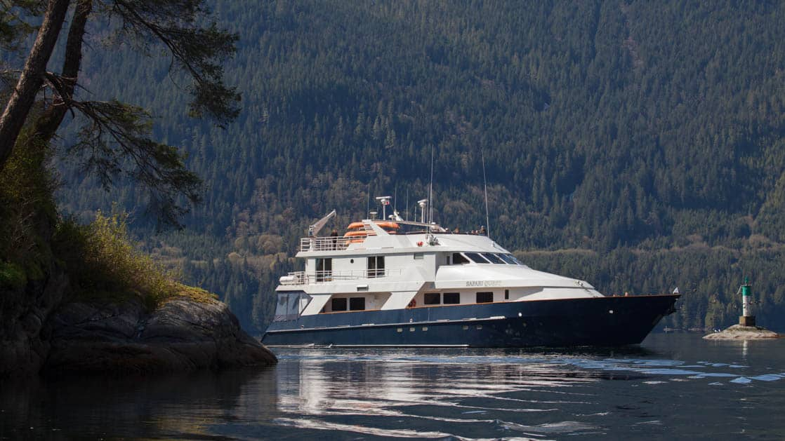 safari quest small ship travels on a pacific northwest river during the Olympic Wilderness & San Juan Islands cruise