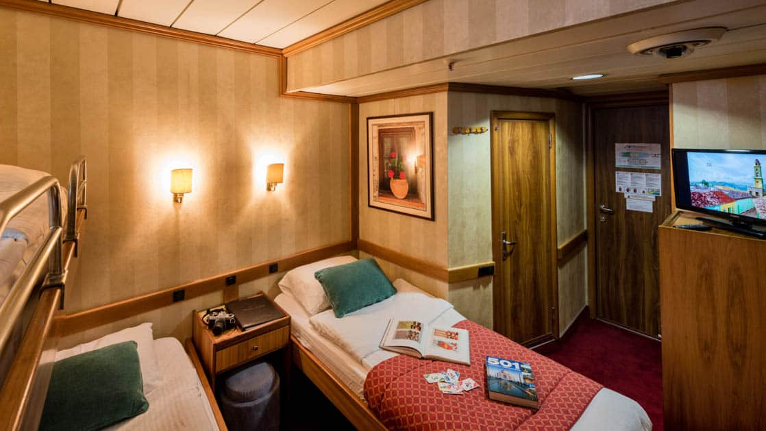 panorama Mediterranean yacht room with three beds and a picture on the wall
