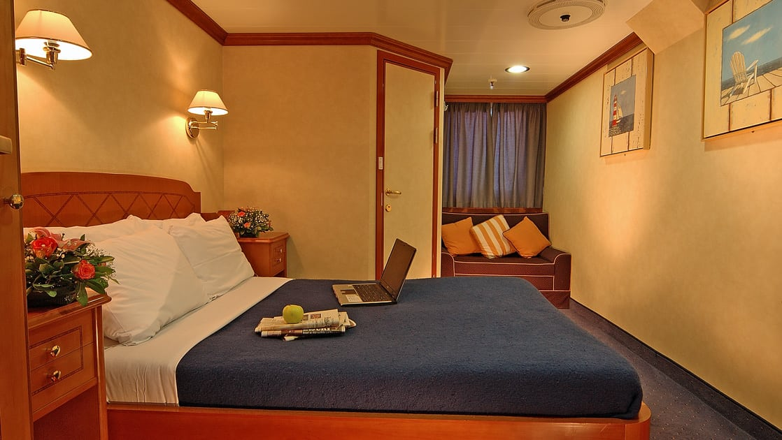 Panorama II mediterranean yachtDouble Cabin with large bed and door and window in the background