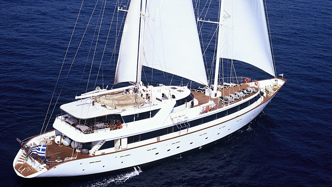 Panorama II luxury yacht exterior with sails out cruising on the mediterranean