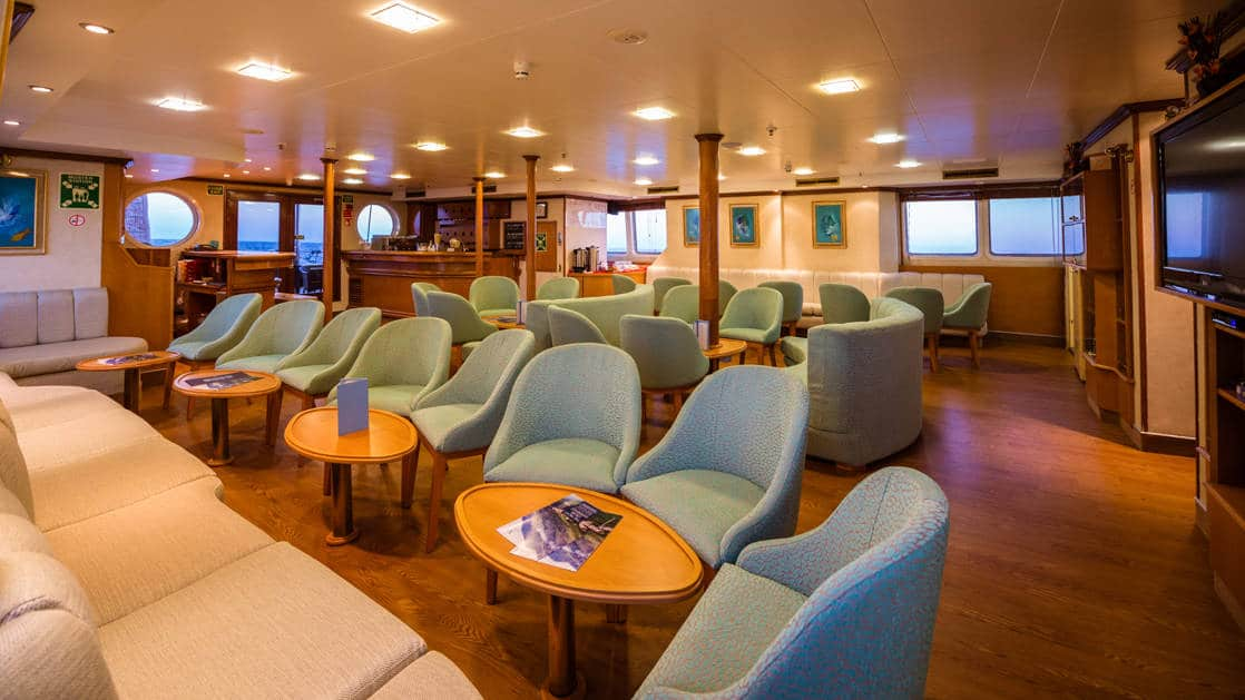 Lounge bar with many chairs and seating areas aboard Panorama II