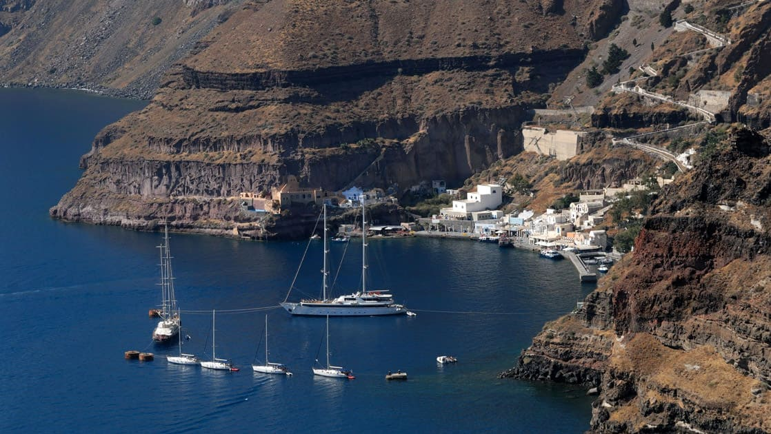 Panorama II yacht anchored in a cove at Santorini on a sunny day