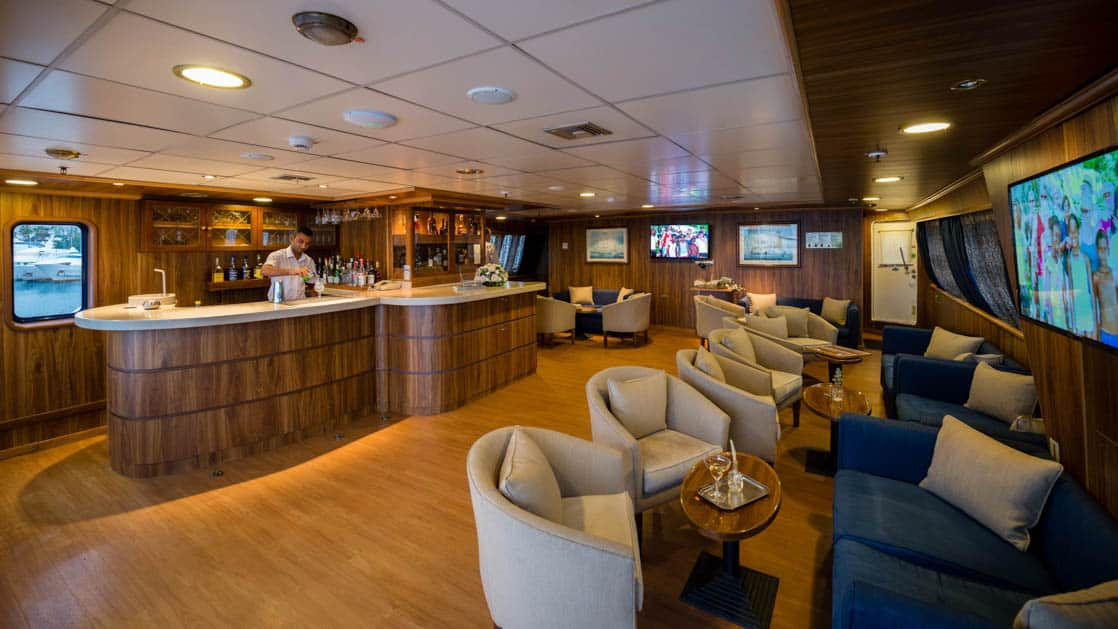 Panorama Mediterranean yacht bar and lounge with rows of comfortable chairs