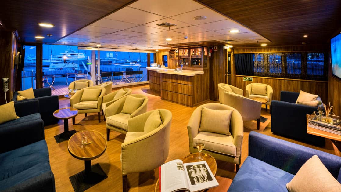 bar and lounge with plush chairs aboard the Panorama Mediterranean luxury yacht