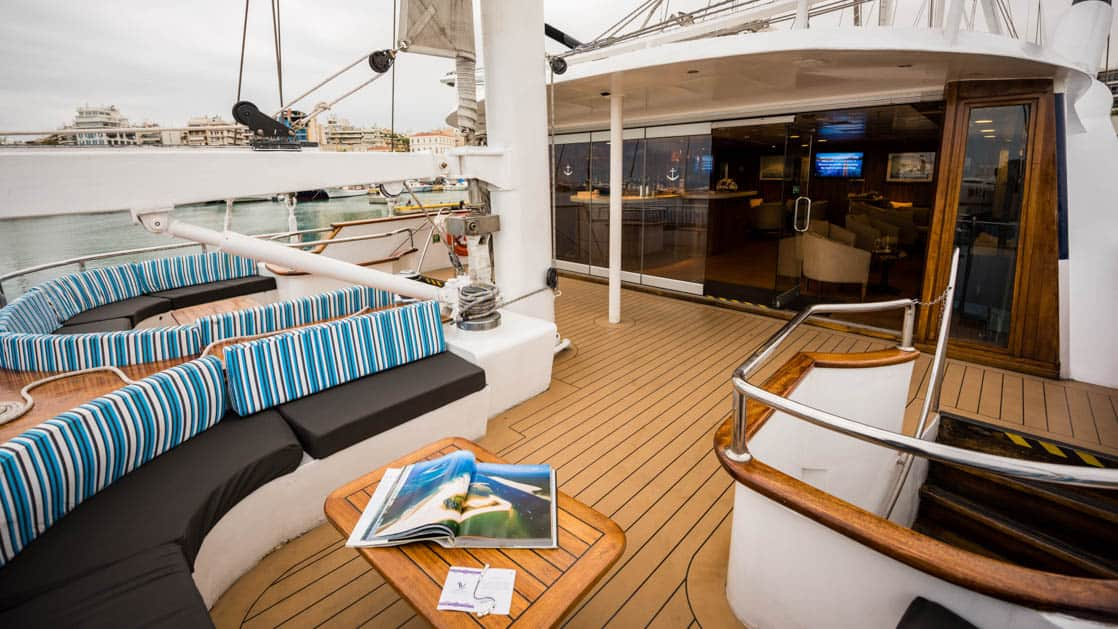outside deck with a table and bench aboard the Panorama Mediterranean luxury yachtPanorama Mediterranean luxury yacht